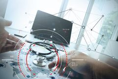 Doctor working with laptop computer in medical workspace office. Concept of target focus digital diagram,graph interfaces,virtual UI screen,connections netwoork royalty free stock photo