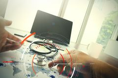 Doctor working with laptop computer in medical workspace office. Concept of target focus digital diagram,graph interfaces,virtual UI screen,connections netwoork royalty free stock image
