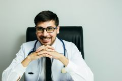 Doctor is working with laptop in his medical office. Doctor is working with laptop in his medical office,Community Health and Development Hospital In Remote Royalty Free Stock Photography