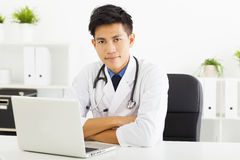 Doctor working with laptop in office Stock Photo