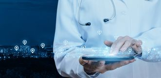 Doctor working at the medical network on the tablet . royalty free stock image