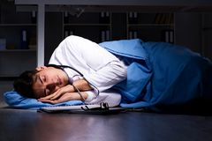 The doctor working night shift in hospital after long hours. Doctor working night shift in hospital after long hours royalty free stock photography