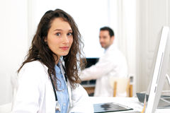 Doctor working at the office assisted with assistant Royalty Free Stock Image