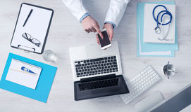 Doctor working at office desk Royalty Free Stock Images