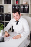 Doctor working open posture in office Royalty Free Stock Photos