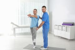 Doctor working with patient in hospital stock photos