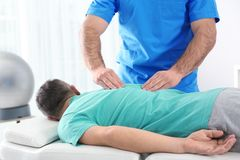Doctor working with patient in hospital. Rehabilitation royalty free stock photos