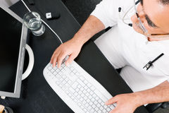 Doctor working at the PC Stock Photography