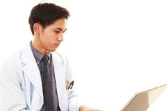 Doctor working on PC Stock Image
