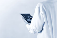 Doctor working radiographs on digital tablet stock image