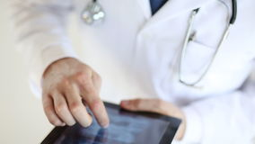 Doctor working with x-ray scan on tablet pc. Professional doctor working with x-ray scan on tablet pc stock footage
