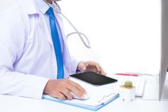Doctor. The doctor is working in the room royalty free stock photo
