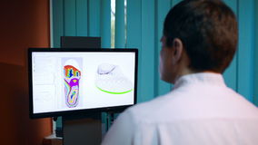 Doctor working with shoe modeling using foot scan Stock Images