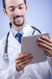 Doctor working on the tablet Stock Photo