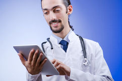 Doctor working on the tablet Stock Image