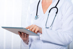 Doctor working with  tablet, Royalty Free Stock Photo