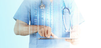 Doctor working with tablet computer Royalty Free Stock Photo