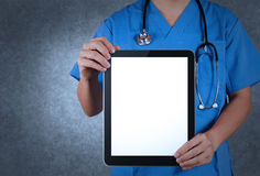 Doctor working with tablet computer Stock Images
