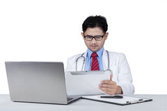 Doctor working with tablet and laptop Stock Images