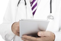 Doctor working on a tablet -pc Royalty Free Stock Image