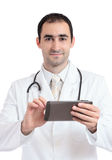 Doctor working on tablet pc at work. Stock Image
