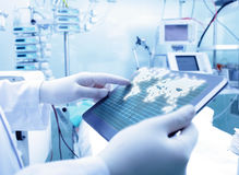 Doctor working with tablet PC and world map Royalty Free Stock Photos