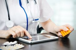 Doctor working on a tablet Royalty Free Stock Images