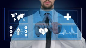 Doctor working on a virtual screen. medical technology concept. pulse stock footage