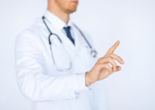 Doctor working with virtual screen Stock Photos
