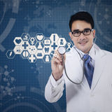 Doctor working with virtual screen Stock Images