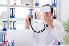The doctor working with virtual vr reality glasses Royalty Free Stock Image