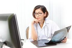 doctor working by watching to computer monitor Royalty Free Stock Image
