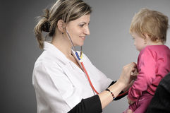 Doctor Working With Baby Girl Stock Photos