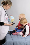 Doctor Working With Children Stock Image