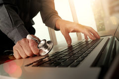 Doctor working at workspace with laptop computer Stock Photo