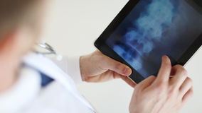 Doctor working with x-ray scan on tablet pc