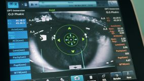 Doctor works with medical monitor with an eye.