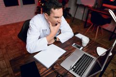 The doctor works on New Year`s Eve. He is very tired but continues to work. Royalty Free Stock Photo