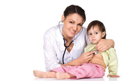 Doctor works with nice kid Stock Photos