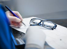 Doctor works with patient data Stock Images