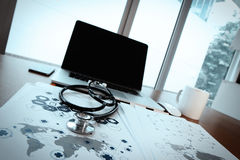 Doctor workspace with laptop computer in medical workspace Stock Image