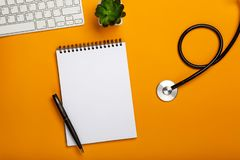 Doctor workspace with Medical equipment on yellow table stock images