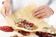 Doctor Wrapping Chinese Herbal Medicine. Royalty Free Stock Photography