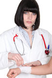 Doctor wrapping a wound Royalty Free Stock Photo