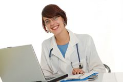 Doctor write medical reports Stock Image