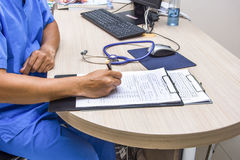 Doctor write order note stetchoscope and keyboard on the desk Stock Image