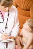 Doctor write receipt for little patient stock photos