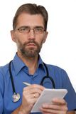 Doctor writes in a notebook. To the clinic Stock Photos