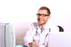 Doctor writes a patient a prescription Royalty Free Stock Photos