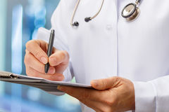 The doctor writes a prescription . Royalty Free Stock Photography
